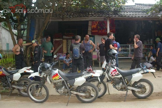 Offroad Vietnam Motorbike Adventures - Touring Vietnam On Honda XR250. Stop at a local shop on the road, motorcycling Vietnam.