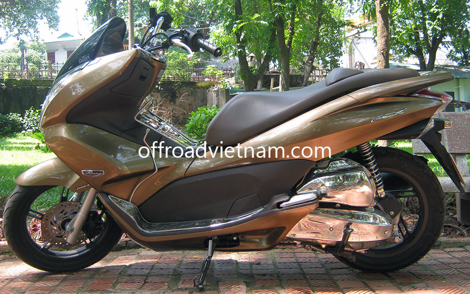 Offroad Vietnam Scooter Rental - Honda PCX 125cc Touring Scooter In Hanoi. Brown Honda PCX 125cc Touring Scooter Without Rear Box, Front Disc Combi-Brake