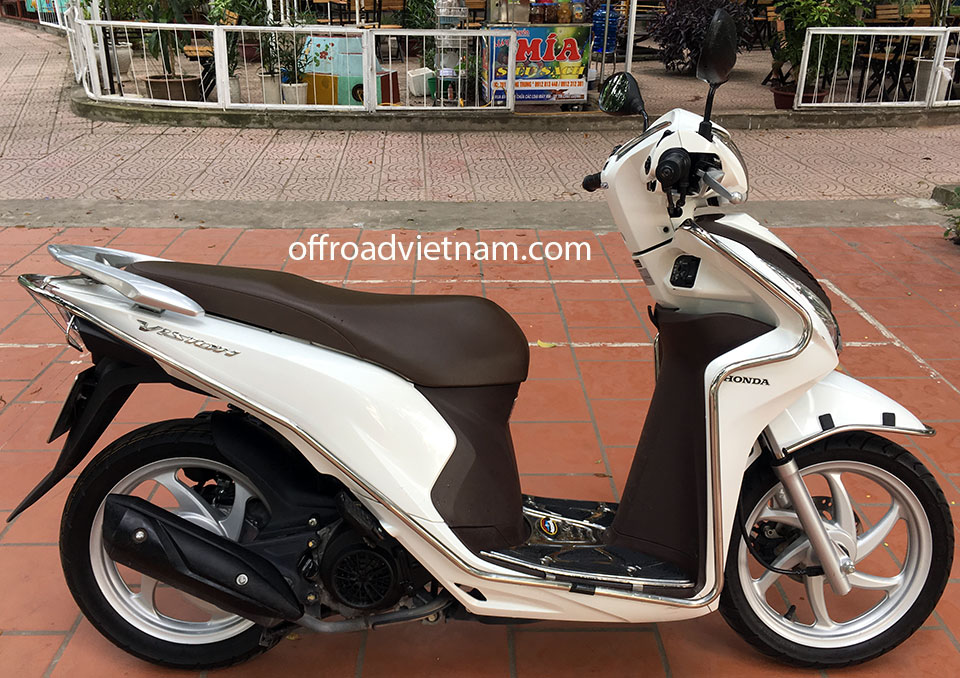 Offroad Vietnam Scooter Rental - 2015 Honda Vision 110cc In Hanoi. Honda automatic scooter, white Honda Vision 110cc with stainless steel protection frame.
