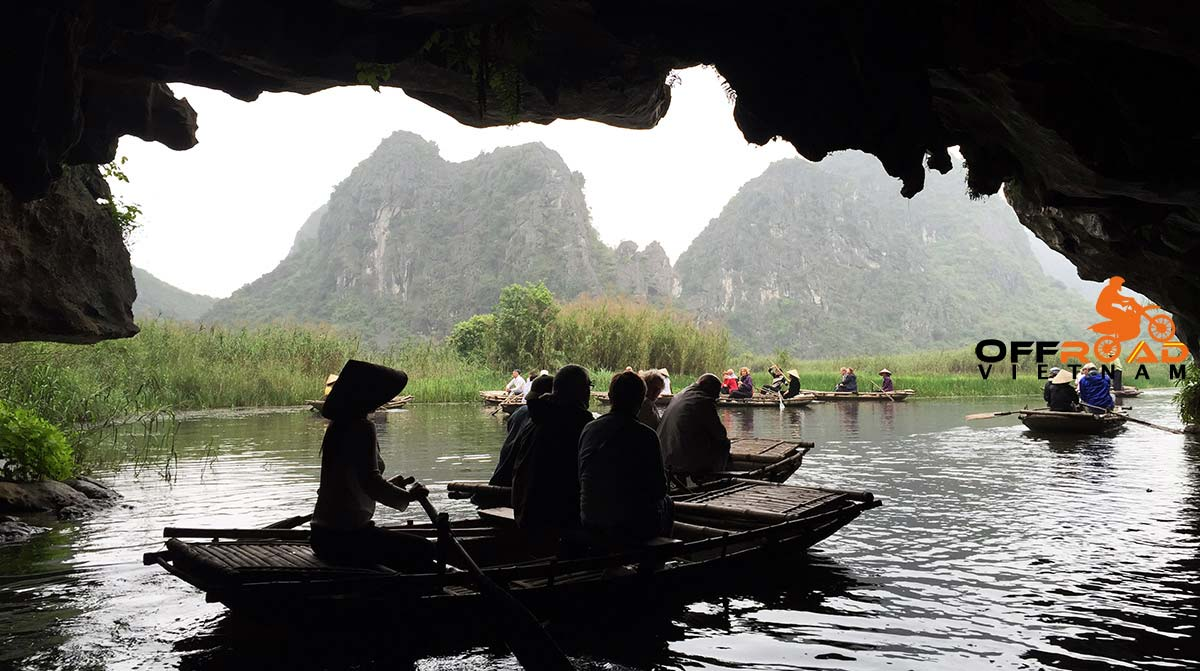 Offroad Vietnam Motorbike Adventures - Two Halong Bays In 6 Days Motorbike Tour. Boating in Tam Coc, the dry Halong Bay in Ninh Binh.
