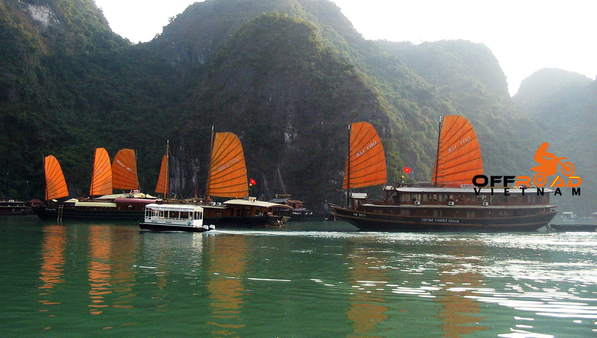Offroad Vietnam Motorbike Adventures - Cruise Kayak Tours In Vietnam: Boat cruise in Halong Bay with group tours with small sails.