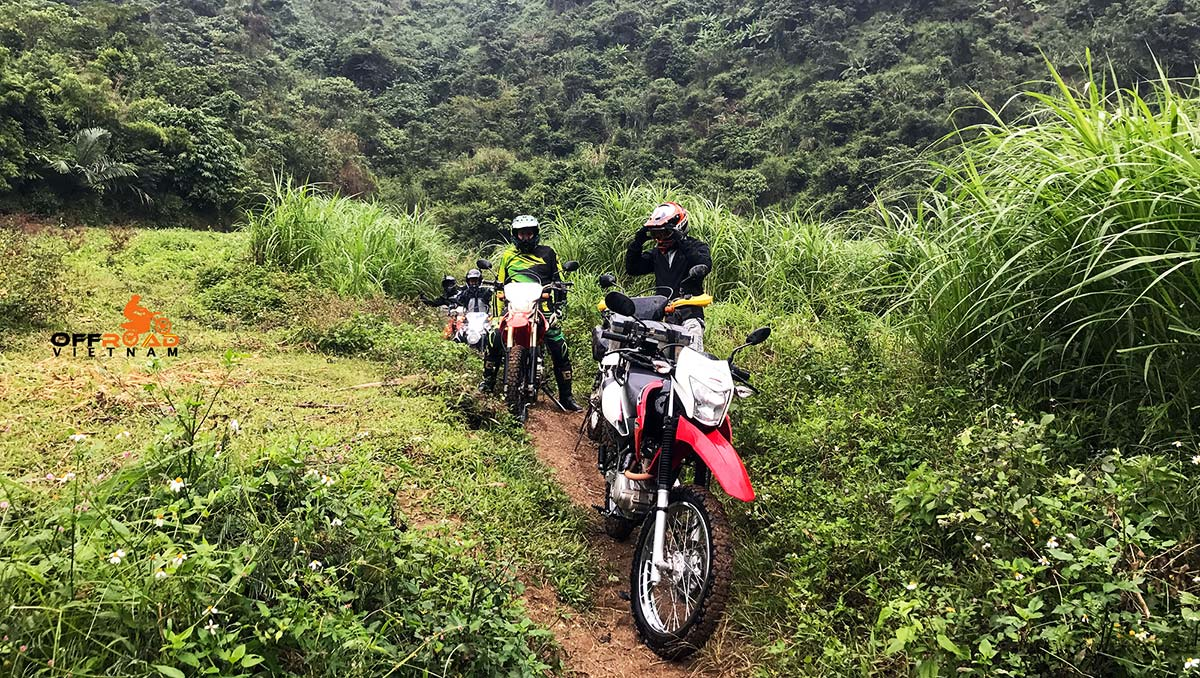Offroad Vietnam Motorbike Adventures - Challenging 6-Day Big North Motorbiking For Experienced Riders in Ba Be with stream crossing.