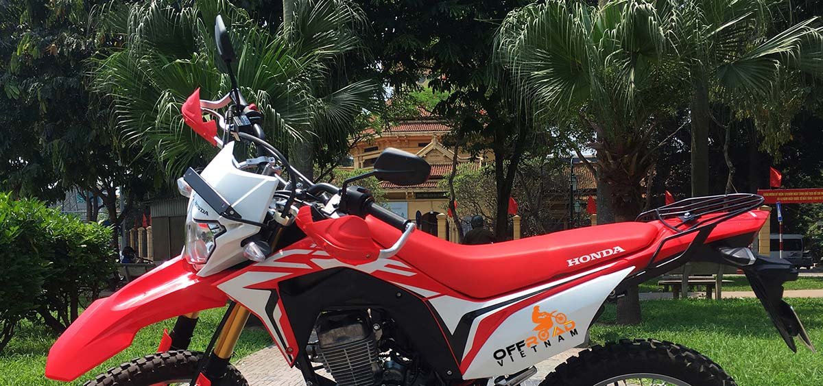 Offroad Vietnam Dirt Bike Rental - 2019 Honda dirt (trail) bike Honda CRF150L 150cc Red & White, front and back disc brake, with safe handle bar protection.