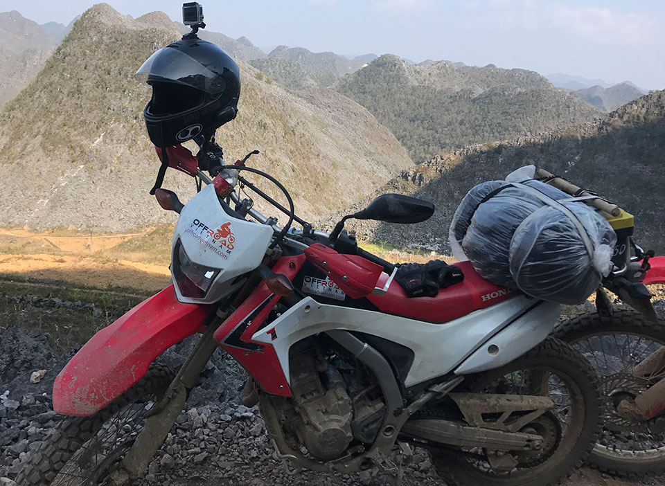 Offroad Vietnam Dirt Bike Rental - Honda CRF250L 250cc In Hanoi. 2014-2017 Honda dirt (trail) bike Honda CRF250L 250cc Red & White, front disc brake, back drum brake with rear luggage rack on a Ha Giang motorbike tour.