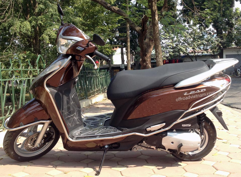 Offroad Vietnam Scooter Rental - Honda Lead 125cc In Hanoi. Honda automatic scooter, brown Honda Lead 125cc with stainless steel protection frame.