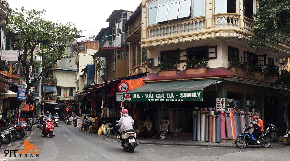 Offroad Vietnam Motorbike Adventures - Repair services for your bikes in Hanoi: Motorcycle seat cover at Ha Trung street in Hanoi, Vietnam.