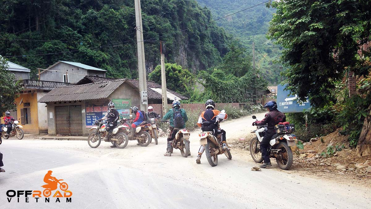 Offroad Vietnam Motorbike Adventures - Touring Vietnam On Honda XR250. Stop at a local intersection on the road, motorcycling Vietnam.