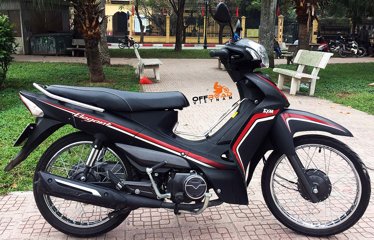 Offroad Vietnam Motorbike Adventures - Rent 50cc Motorbikes & Scooters Rentals In Hanoi. Offroad Vietnam provides moped scooter tours and rentals in Hanoi. This is a 2017 black SYM Elegant semi-automatic motorbike 50cc from right