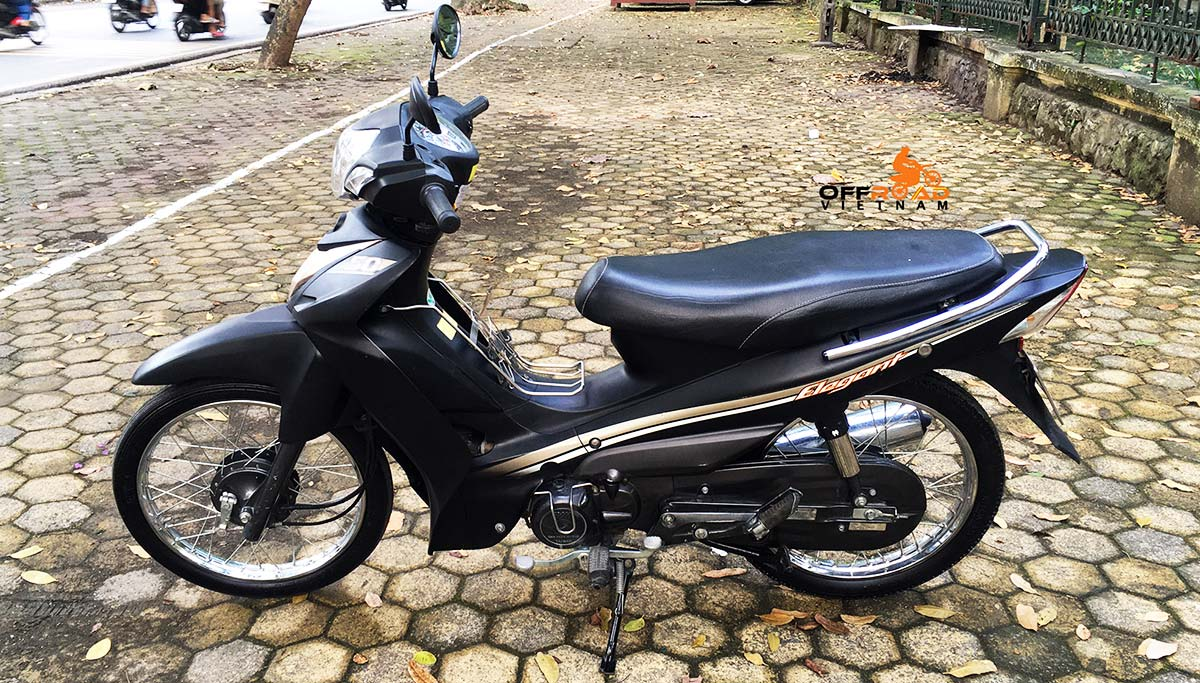Offroad Vietnam Motorbike Adventures - Rent 50cc Motorbikes & Scooters Rentals In Hanoi. Offroad Vietnam provides moped scooter tours and rentals in Hanoi. This is a 2017 black SYM Elegant semi-automatic motorbike 50cc from left