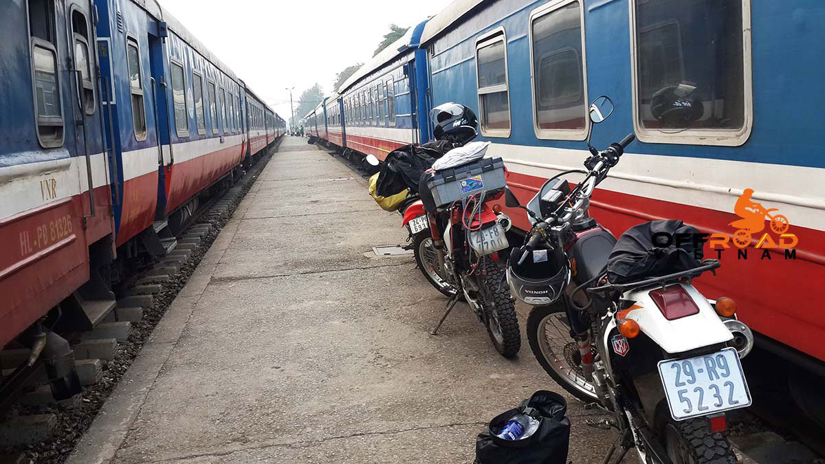 Offroad Vietnam Motorbike Adventures - Train Tours In Vietnam, loading motorbike on a train from Hanoi to Lao Cai.