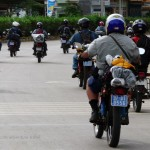 Leaving Hanoi through busy traffic on an Offroad Vietnam motorbike tour