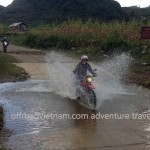 Vietnam motorbike tours, Vietnam motorcycle tours. Crossing a Northwest stream