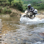 Crossing a stream on an Offroad Vietnam dirt bike tour